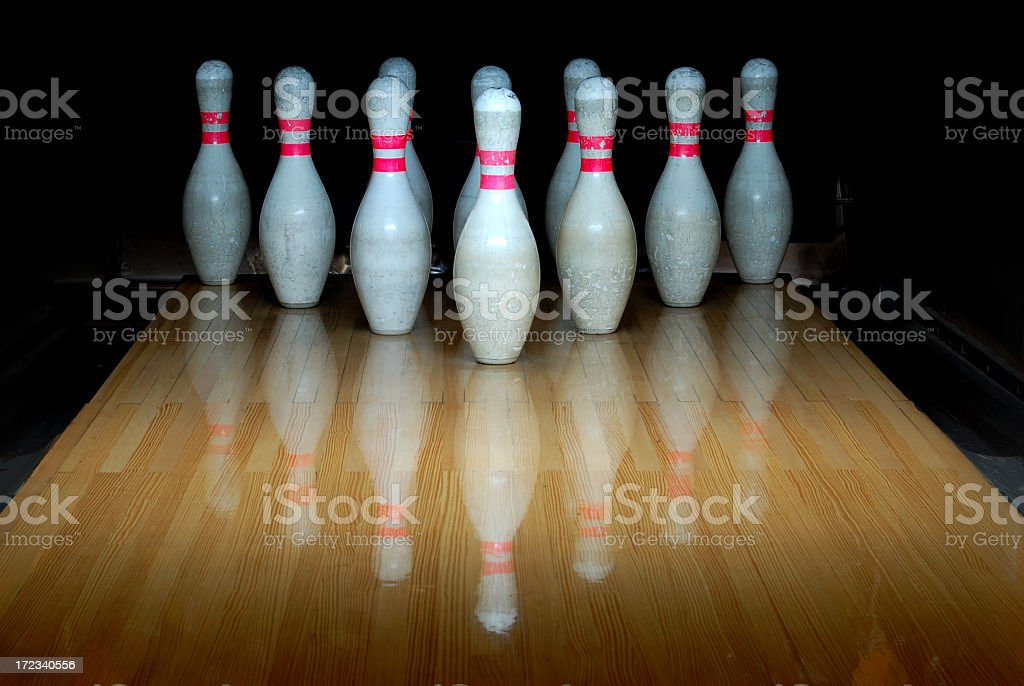 Bowling pins standing in the he alley stock photo