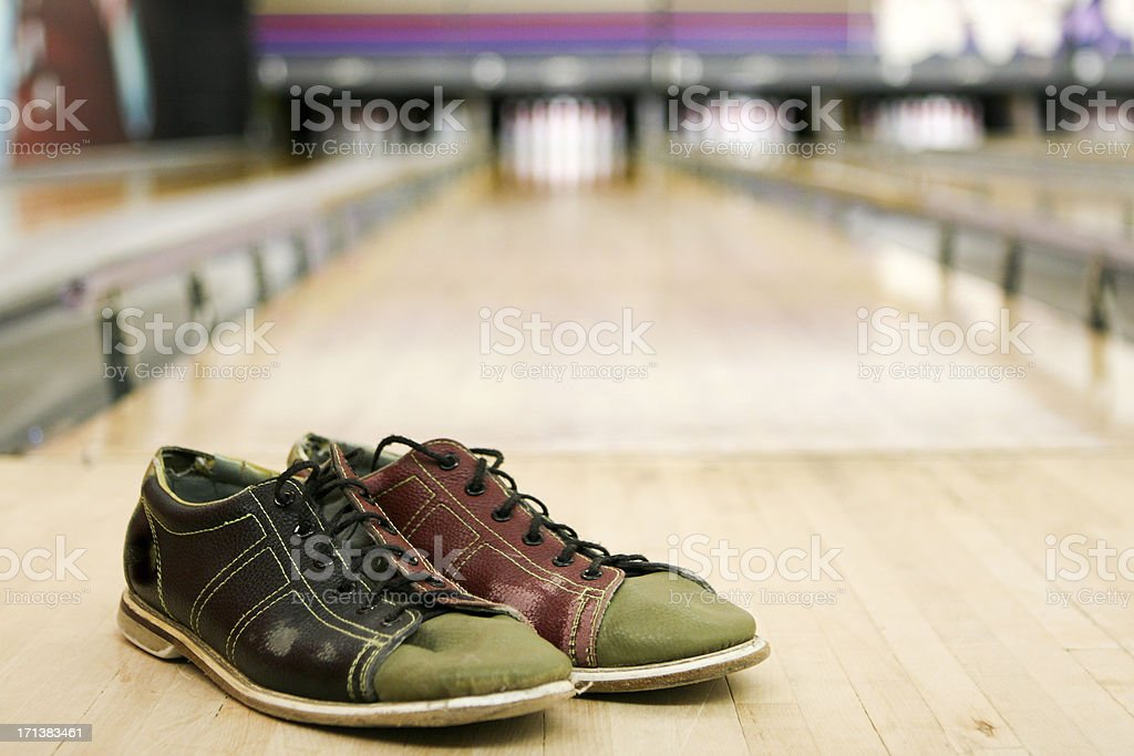 Bowling shoes on alley stock photo