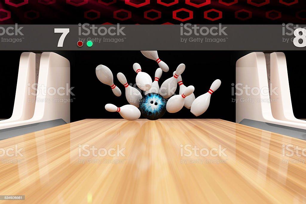 Bowling Strike. Bowling Ball crashing into the Pins stock photo