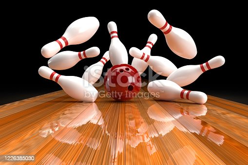 3D graphics of bowling ball and fallen skittles on the playing field