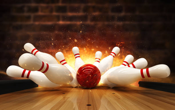 Bowling strike hit with fire explosion Bowling strike hit with fire explosion. Concept of success and win. knocked down stock pictures, royalty-free photos & images