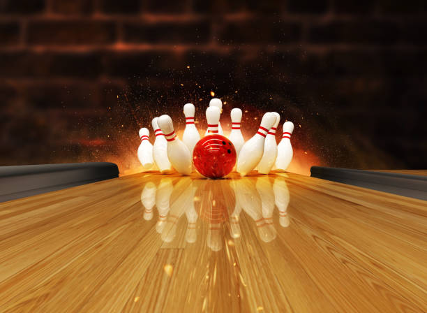 Bowling strike hit with fire explosion stock photo