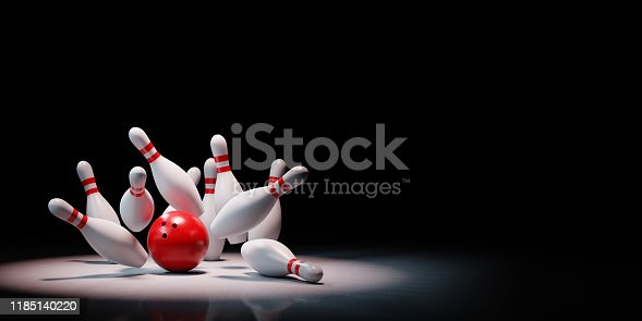 Strike of Red and White Bowling Skittles with Red Ball Spotlighted on Black Background with Copy Space 3D Illustration