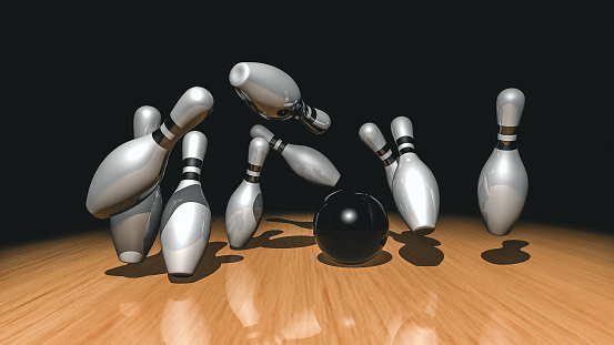 Bowling ball crashing into the pins. 3d rendered.
