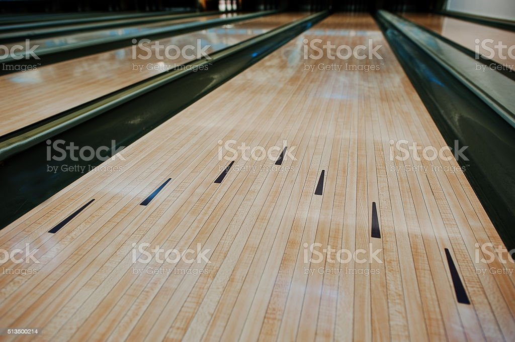 Bowling wooden floor with lane stock photo