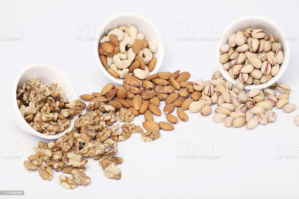 Bowls of Almond, pistachios and walnuts royalty-free stock photo