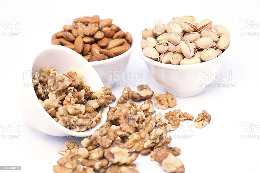 Bowls of Almond,pistachios and walnuts royalty-free stock photo