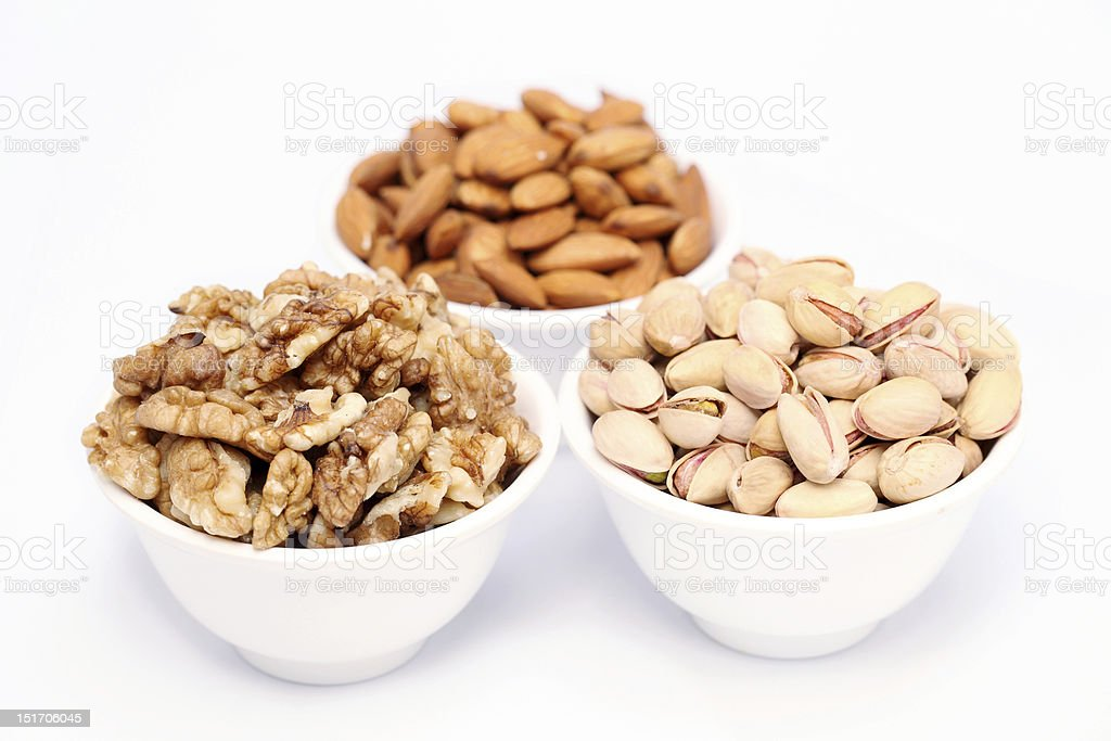 Bowls of almonds,walnuts and pistachios royalty-free stock photo