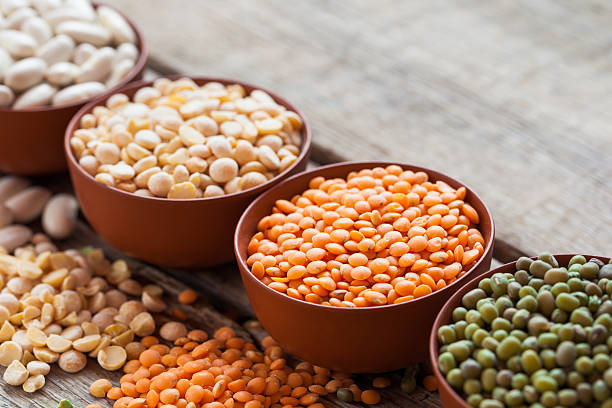 bowls of cereal grain - bean stock photos and pictures