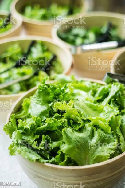 Bowls of fresh organic green lettuce leaves in salad bar display picture id997816756?b=1&k=6&m=997816756&s=612x612&h=ge2jogvvgtru7ji7ynsyw3g0oeqtvlyax9b9223op6y=