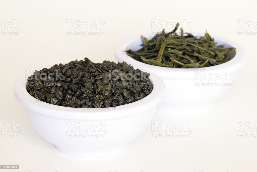 Bowls of green tea leaves royalty-free stock photo