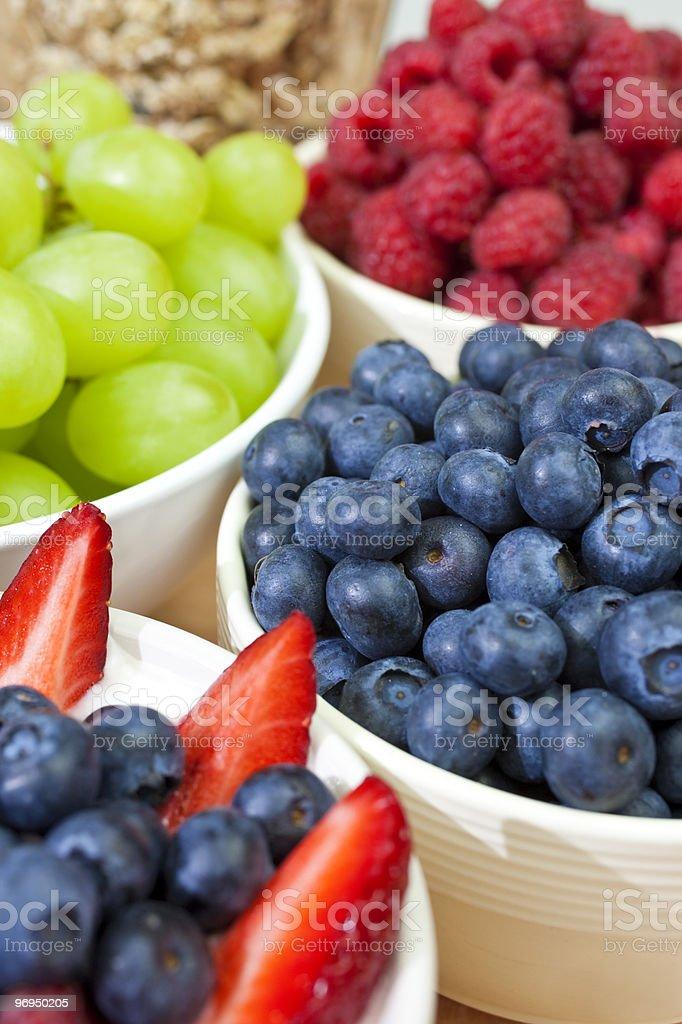 Bowls of Healthy Breakfast Blueberries Raspberries Strawberries & Grapes royalty-free stock photo