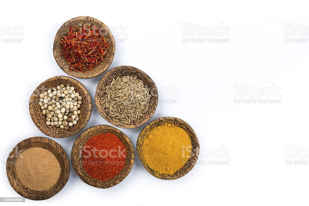 Bowls of spices isolated on white stock photo