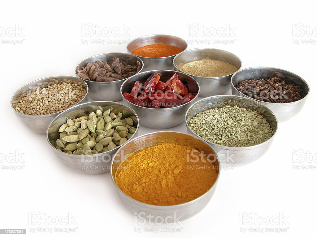 bowls of spices on a white background royalty-free stock photo