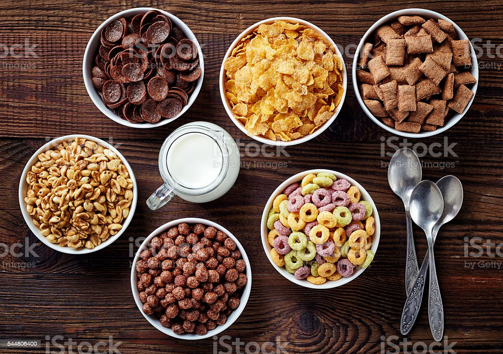 Bowls of various cereals stock photo