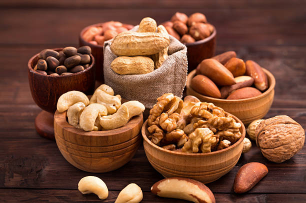 Bowls of various nuts​​​ foto