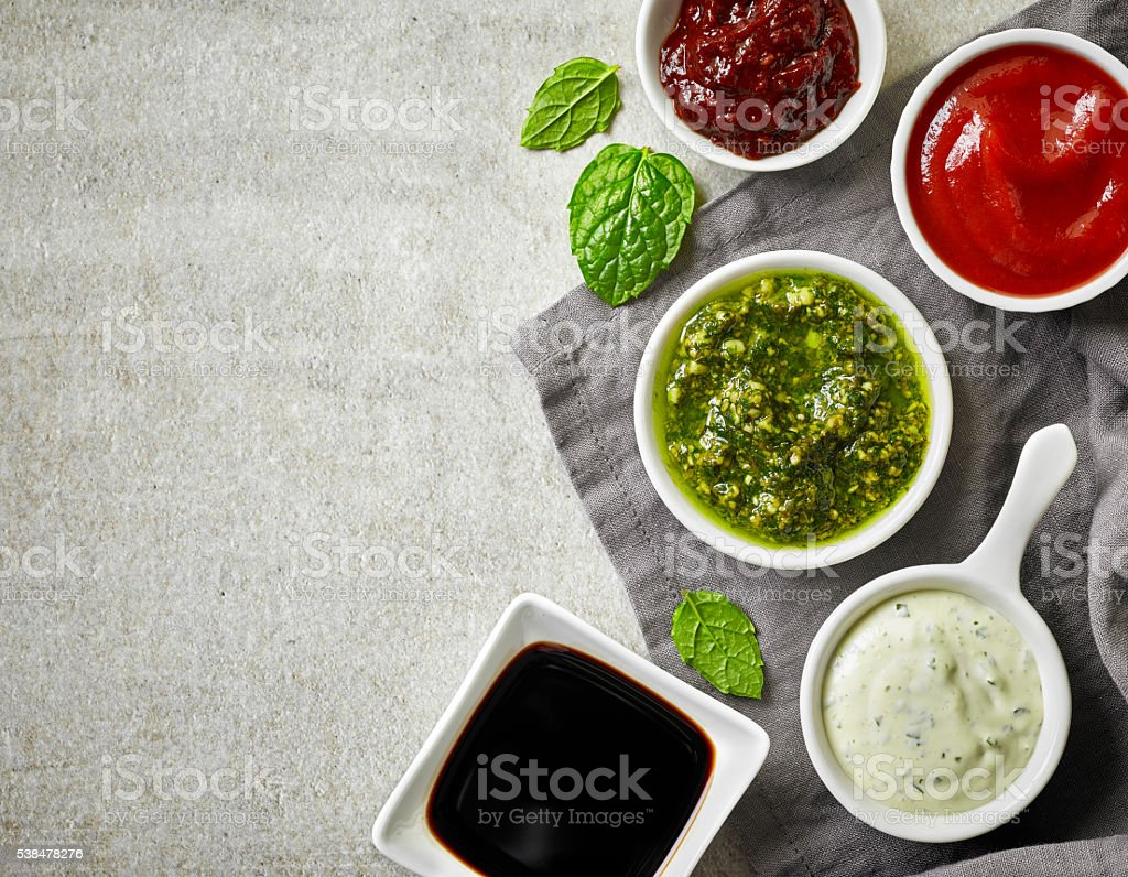 bowls of various sauces stock photo