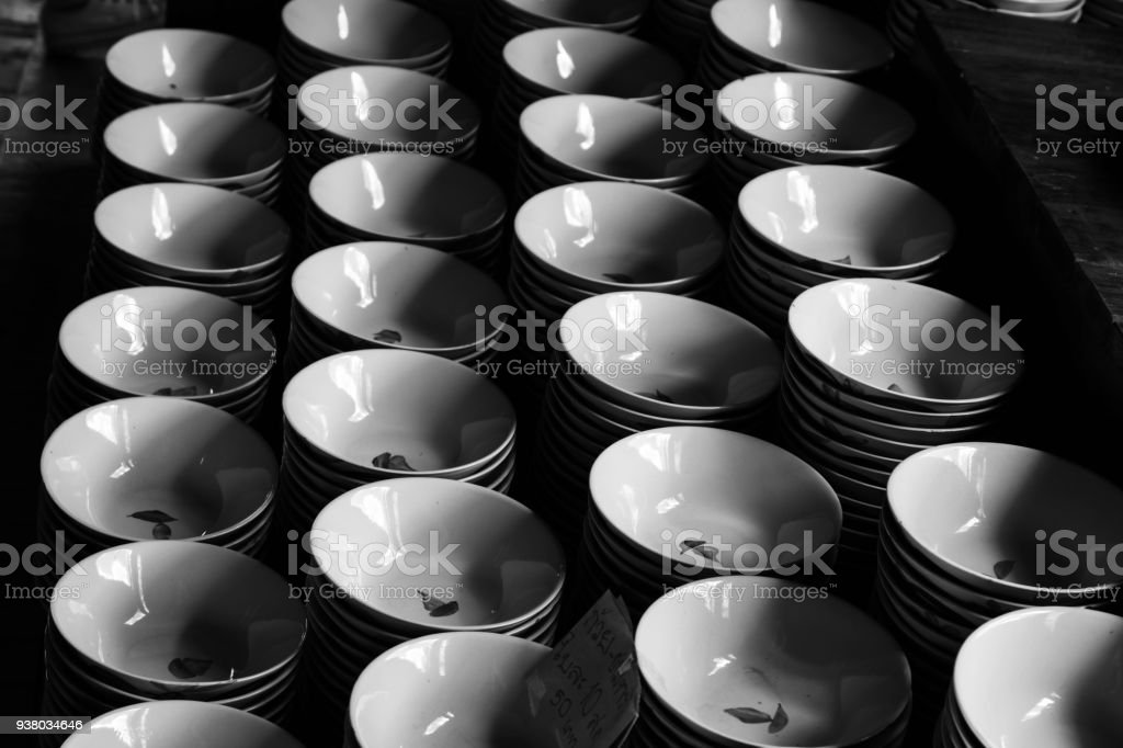 Bowls stacked in rows, black and white. stock photo