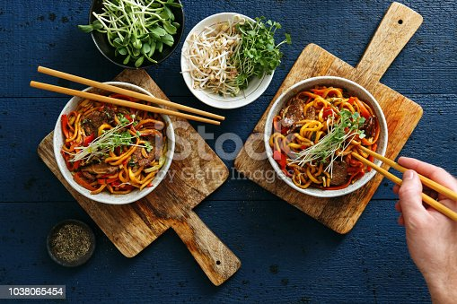 Bowls with chicken, beef and vegetables chow mein