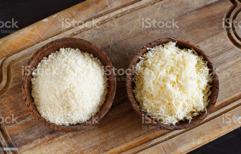 Bowls with grated parmesan cheese stock photo