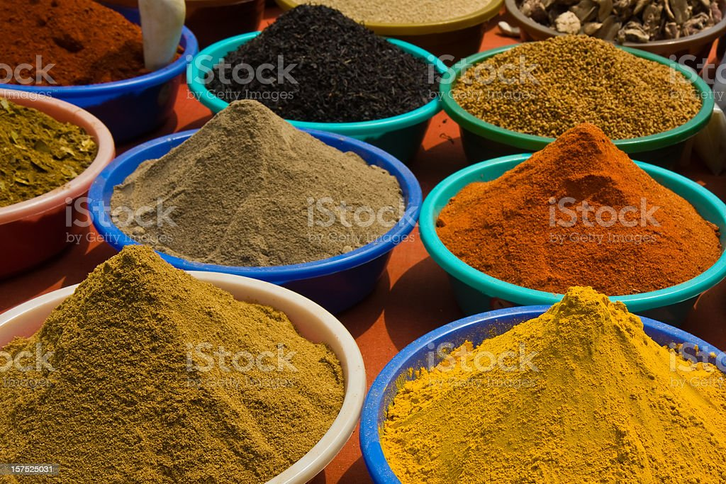 bowls with Indian spices in a shop stock photo