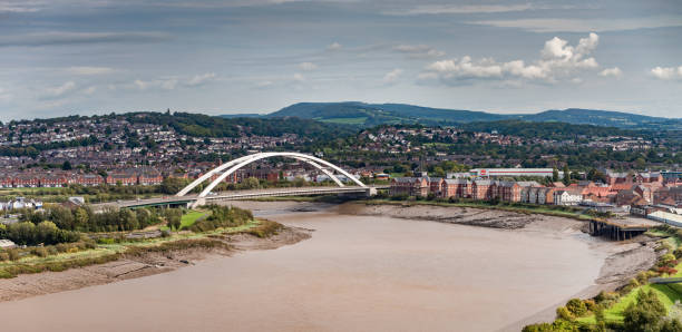 Bowstring bridge carrying A48 across River Usk Newport, UK Bowstring bridge carrying A48 across River Usk Newport, UK south wales stock pictures, royalty-free photos & images