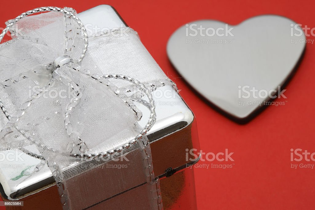 Box and Heart on Red Background royalty-free stock photo