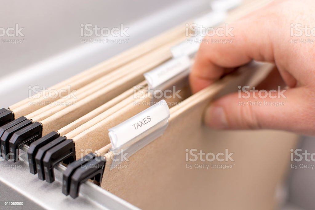 Box File with label - Taxes stock photo