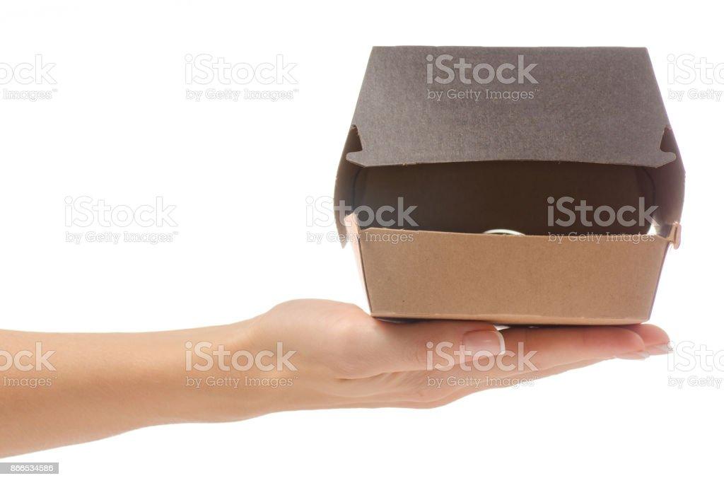 Boîte pour un hamburger dans une main féminine - Photo