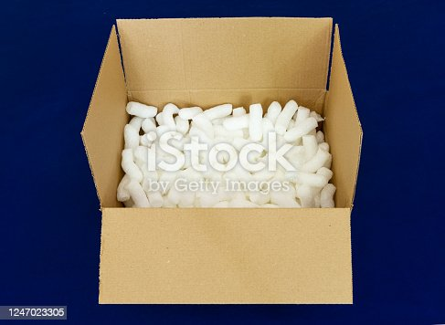 115872043 istock photo Box for shipping with biodegradable packaging peanuts 1247023305