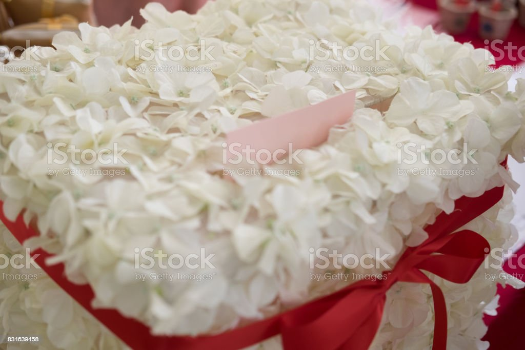 Box for wishes and money for wedding, decoration with white flower