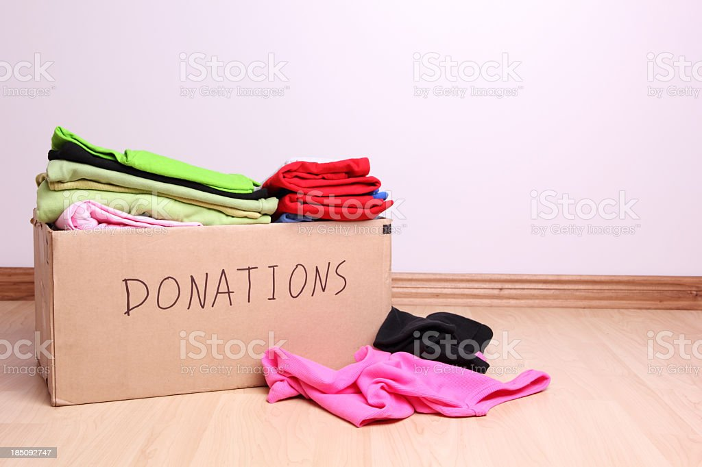 Box full of clothes for donation stock photo