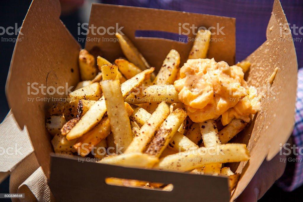Box full of fresh made fries stock photo