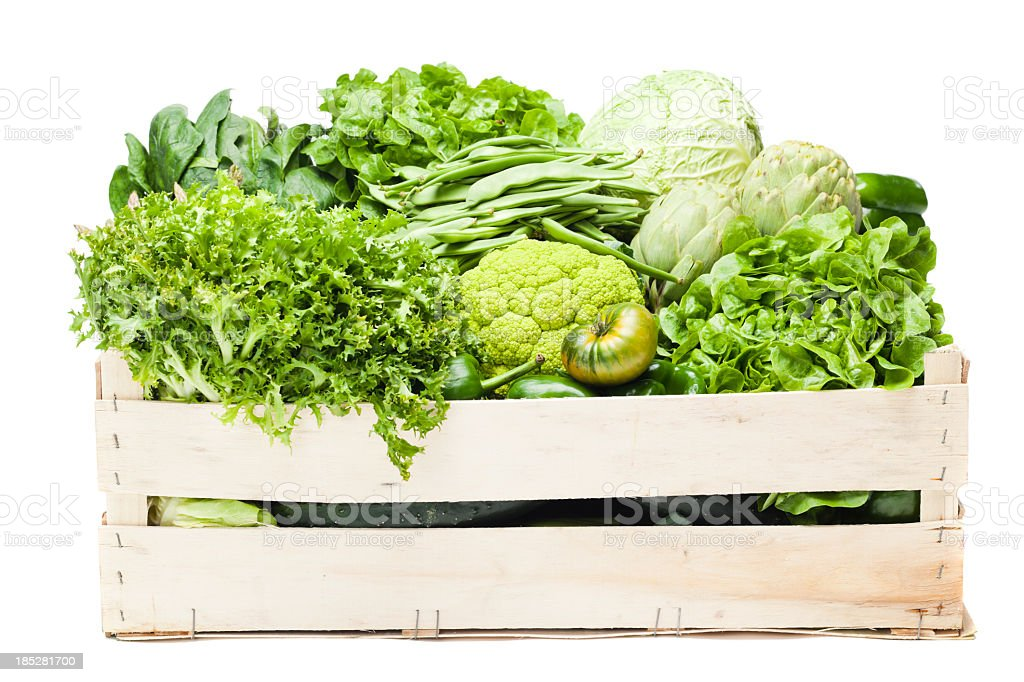 A box full of various green vegetables  stock photo