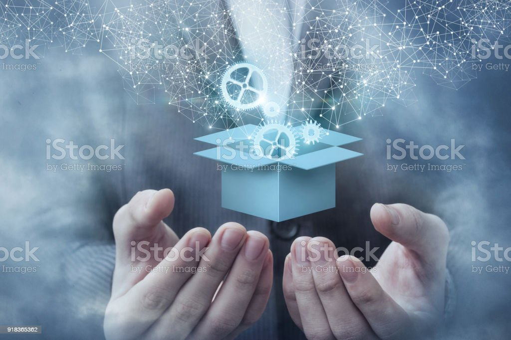 Box in hand is open with the mechanism. stock photo
