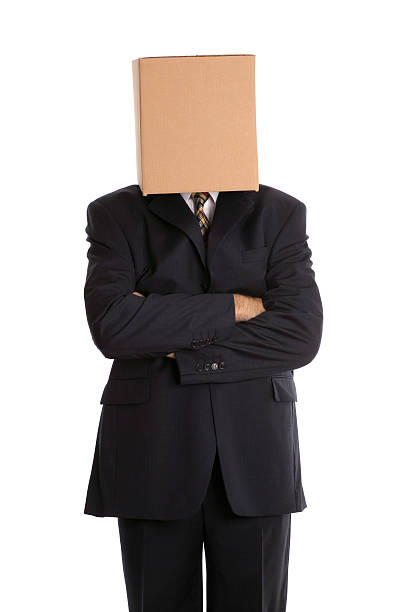 Box man arms folded Anonymous businessman with his arms folded. head in the sand stock pictures, royalty-free photos & images