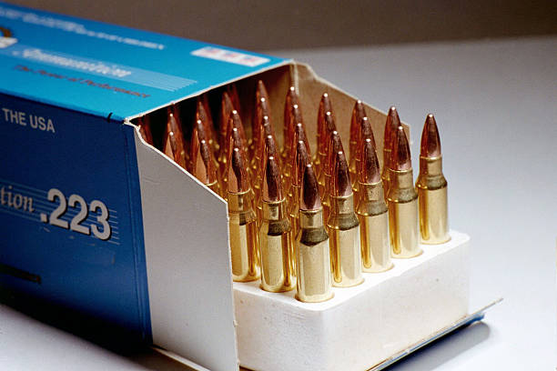 "Box of .223 Ammunition ""An open box of .223 caliber ammunition, same type used in M-16 and AR-15 rifles."" ammunition stock pictures, royalty-free photos & images"