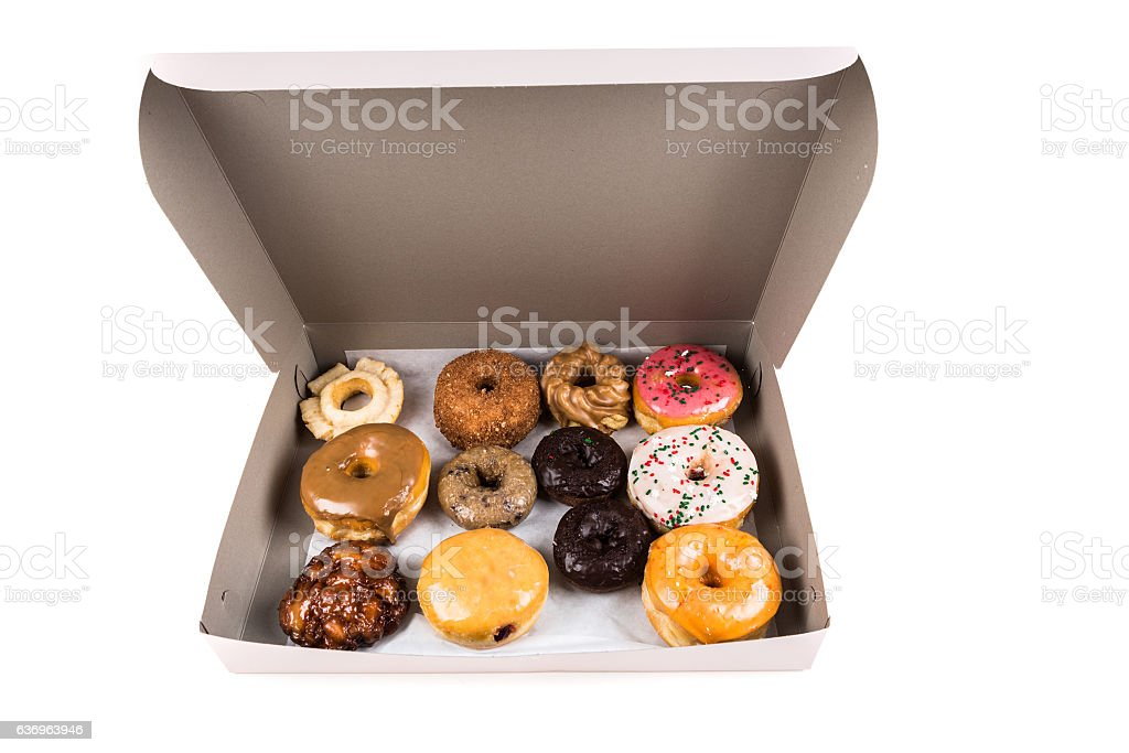 Box of assorted donuts isolated on a white background stock photo