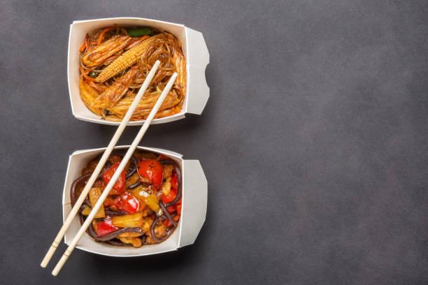 box of Chinese food and chopsticks stock photo