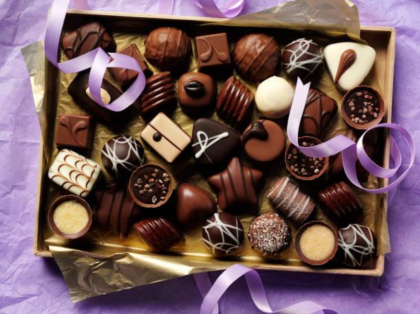 Box of Chocolates on Paper stock photo