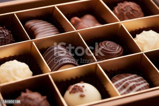 Macro close-up of a gift box of gourmet chocolates.