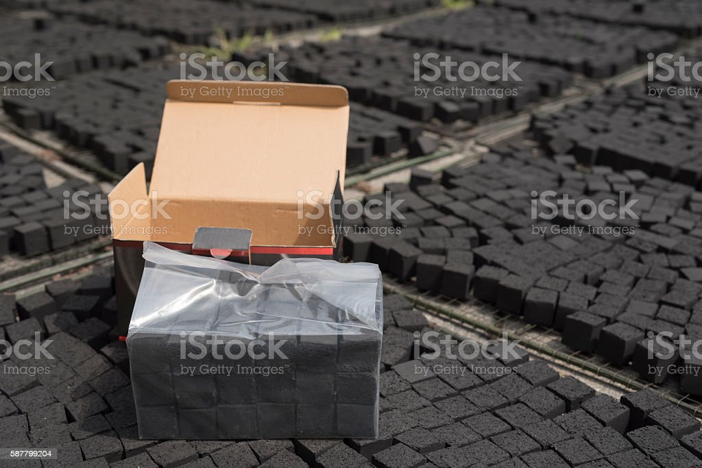 Box of  coconut shell charcoal for shisha stock photo