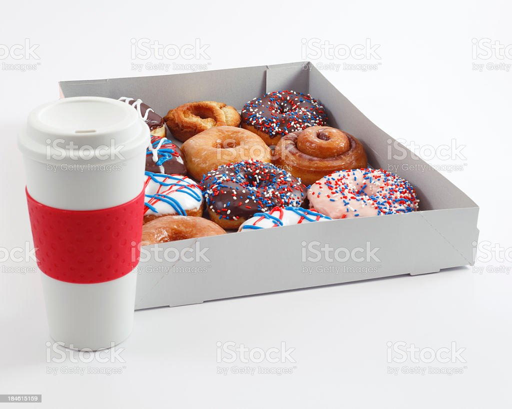 A box of donuts and a cup of coffee stock photo