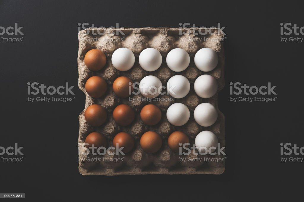 Box of eggs on black background stock photo