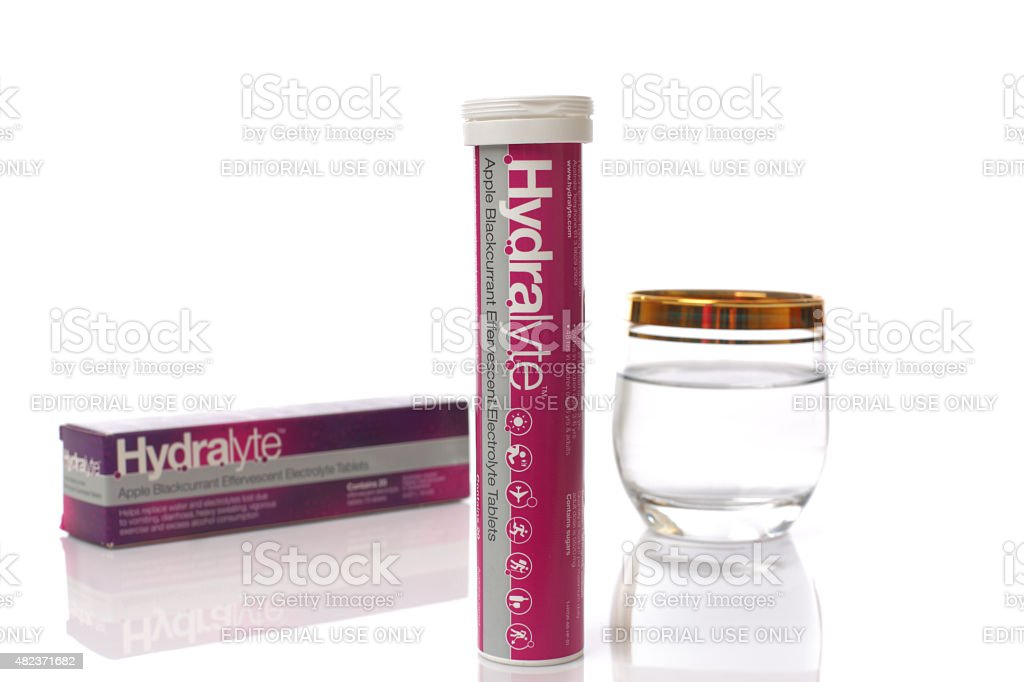 Box of hydralyte effervescent tablets and glass water stock photo