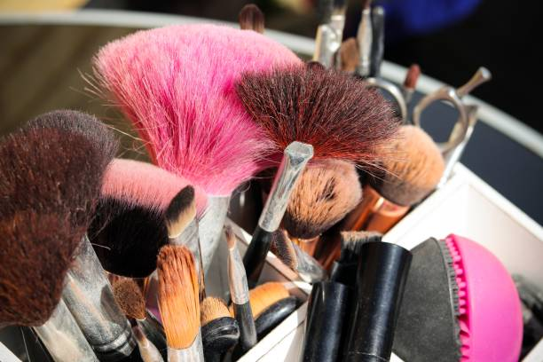 A box of make up brushes stock photo