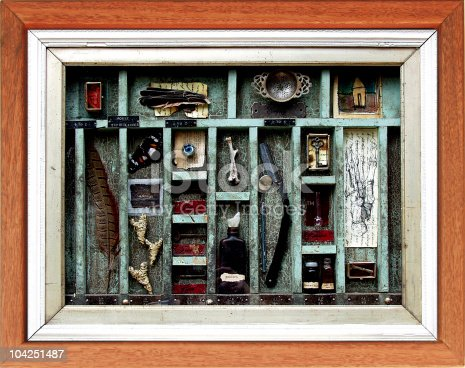 This is an original found object assemblage of my partner's. She has used feathers samples of writing, bones and memorabelia.