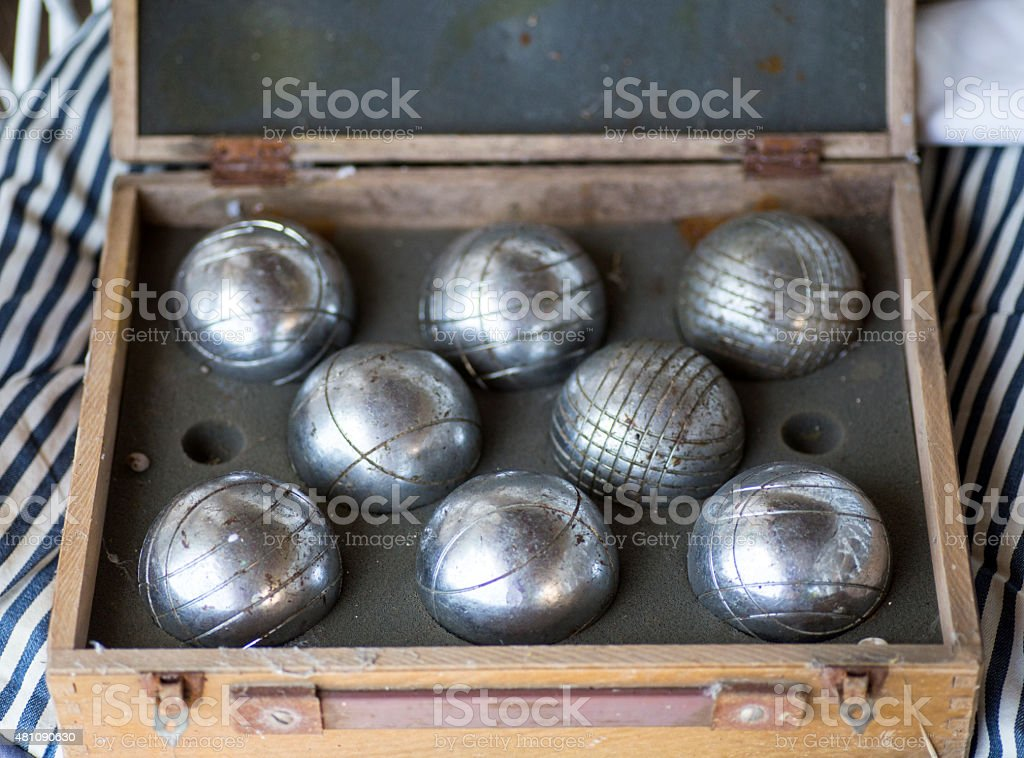 Box of old boules, petanque balls stock photo