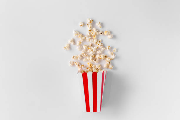 Box of popcorn isolated on white background top view stock photo