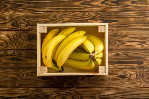 Box of ripe fresh yellow bananas or plantains stock photo